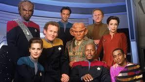The cast of Deep Space Nine, including Worf, Dax, Bashier, Quark, O'Brien, Odo, Sisko, Jake, and Kira.