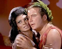 Uhura and Kirk embrace before they share a kiss