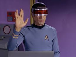 Spock in his visor, giving the Vulcan hand symbol. from letswatchstartrek.com