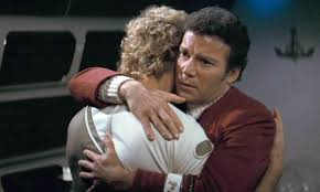 Kirk embraces his son, David