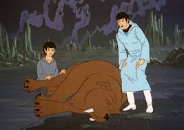 Young Spock and Older Spock looking over his pet after it was bitten