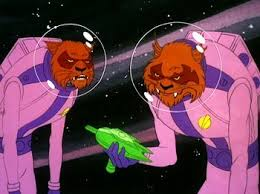 two cat aliens looking at the weapon