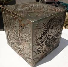 a cube with writings and etchings and symbols over it, known as the allspark in the Transformers universe.