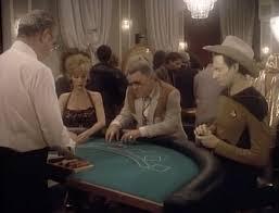 Data wearing a cowboy hat and playing blackjack with a man and a woman