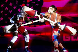 from the show American Gladiators, two men knocking each other over with barbells