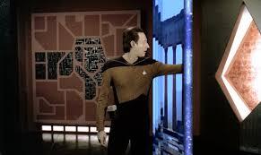 Data putting his hand through the portal