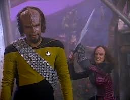 Worf in the foreground and K'ehleyr