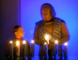 Worf and Jeremy light the candles and speak in Klingon