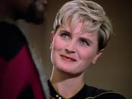 Tasha Yar with an uncharacteristic grin