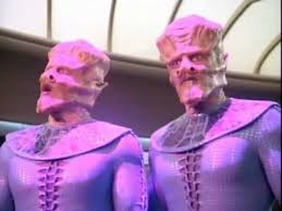 Two of the aliens in the purple light that keeps them in place on the bridge.