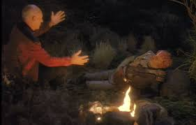 Dathon lays by the fire and listens to Picard tell stories