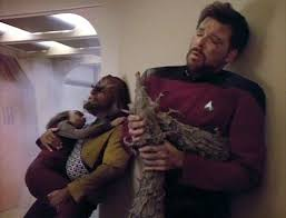 Worf holding Alexander and Riker holding the gilvos after a narrow escape.
