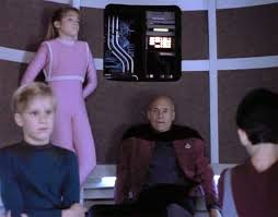 Picard and the children in the turbolift