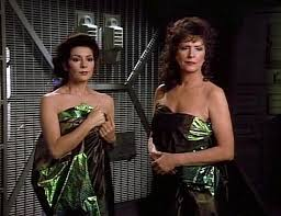 Lwaxana and Deanna were beamed without their clothes on, but Moms are always resourceful and she wraps them in a covering.