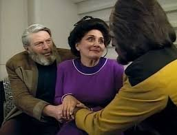 The Rozhenko's and Worf holding hands.
