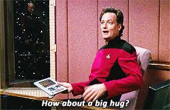 """Q in the captain's chair asking """"How about a big hug""""?"""