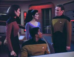 Troi, O'Brien, Ro, and Mandel on the bridge trying to figure out what to do.