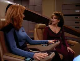 Crusher in the captain's chair and Troi in her usual spot