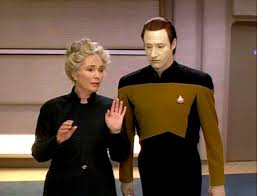 Dr. Juliana and Data walk the halls of the Enterprise