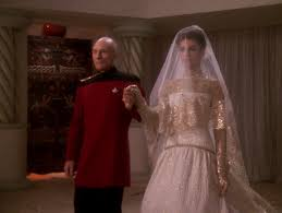 Picard walking Kamala down the asile