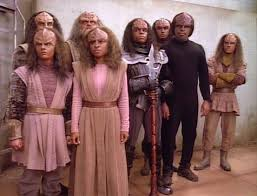 A group of Klingon youths surround Worf, demanding to be allowed to leave or else kill them too.