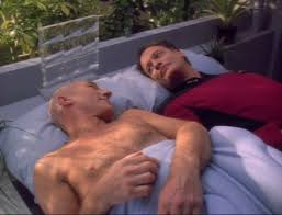 Picard and Q waking up in bed together