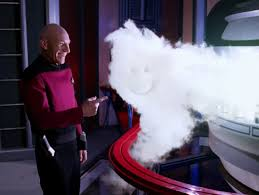Picard laughing at and pointing to the smiley face he just drew in the cloud.