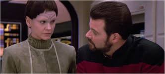 Soren and Riker look at each other in the shuttle craft