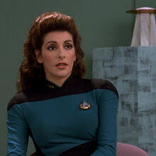 Troi in her Starfleet uniform