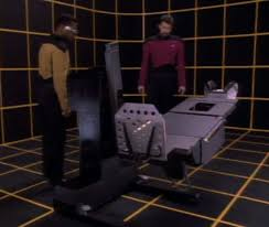 Riker and La Forge look at the recreated table in the holodeck