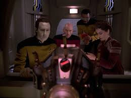 Data, Picard, Farallon, and La Forge administer the test of the exocamp