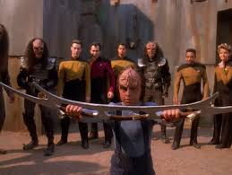 Alexander holding the bat'leth while the rest of Starfleet watches on