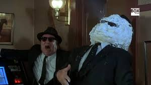 The scene from BLUES BROTHERS where one brother comes out in shaving cream