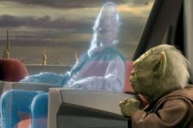 Yoda sitting next to a hologram in the Jedi temple during a council meeting