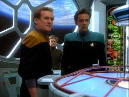 O'Brien and Bashir standing around