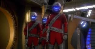 Three hunters in red suits and helmets.