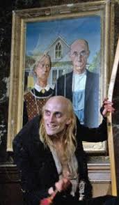 The Farmer and his wife painting with Riff Raff standing in front of it, from RHPS