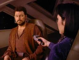Riker and Ro in the shuttlecraft, her holding a phaser to him