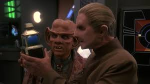 Odo and Quark staring at the baby changeling