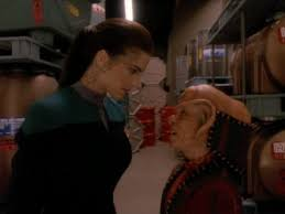 Dax and Nog look at each other i the cargo bay