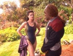 Dax in a bathing suit and Worf staring at her