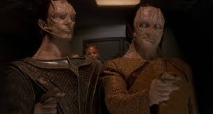 Dukat and Garak standing side by side