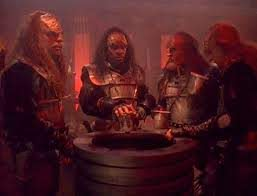 The foursome as Klingons surrounding a vat of bloodwine