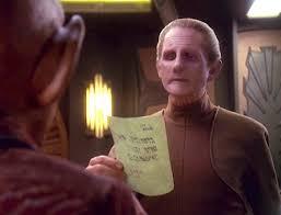 Odo reading a note that Rom left Quark