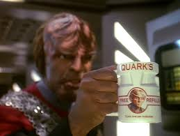 Worf holding the quark mug
