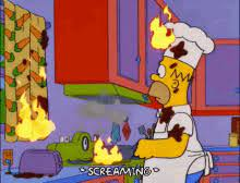 Home Simpson sets the kitchen on fire, and himself