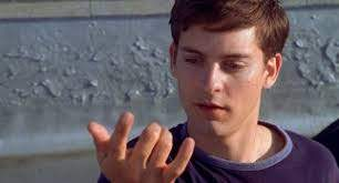 Tobey Maguire spider-man looks at his hand where the webbing comes from