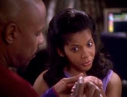 Sisko putting a ring on Yates as she gives excellent face.