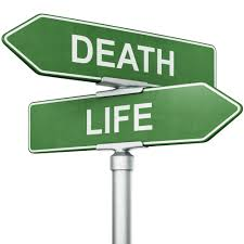 crossroads of life and death as road signs