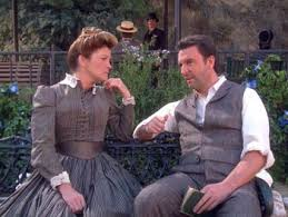 Janeway and Michael Sullivan siting on a bench.